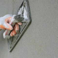 Для чего нужна цементная штукатурка